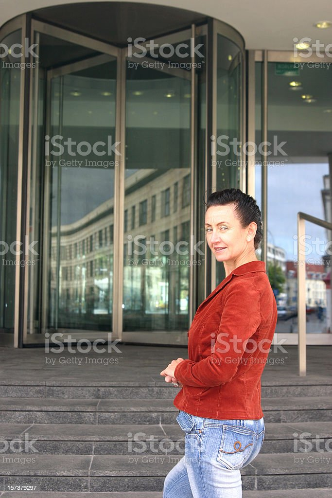 Woman standing near entrance stock photo