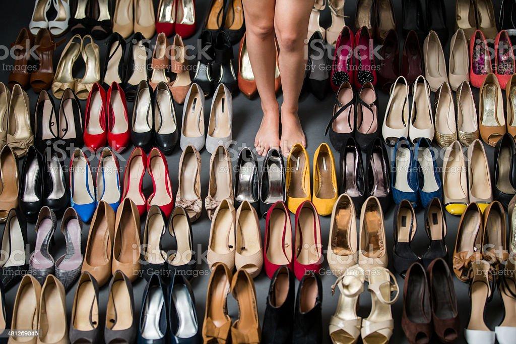 Woman standing near high heels stock photo