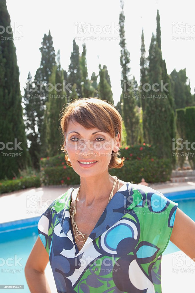 Woman standing near pool stock photo