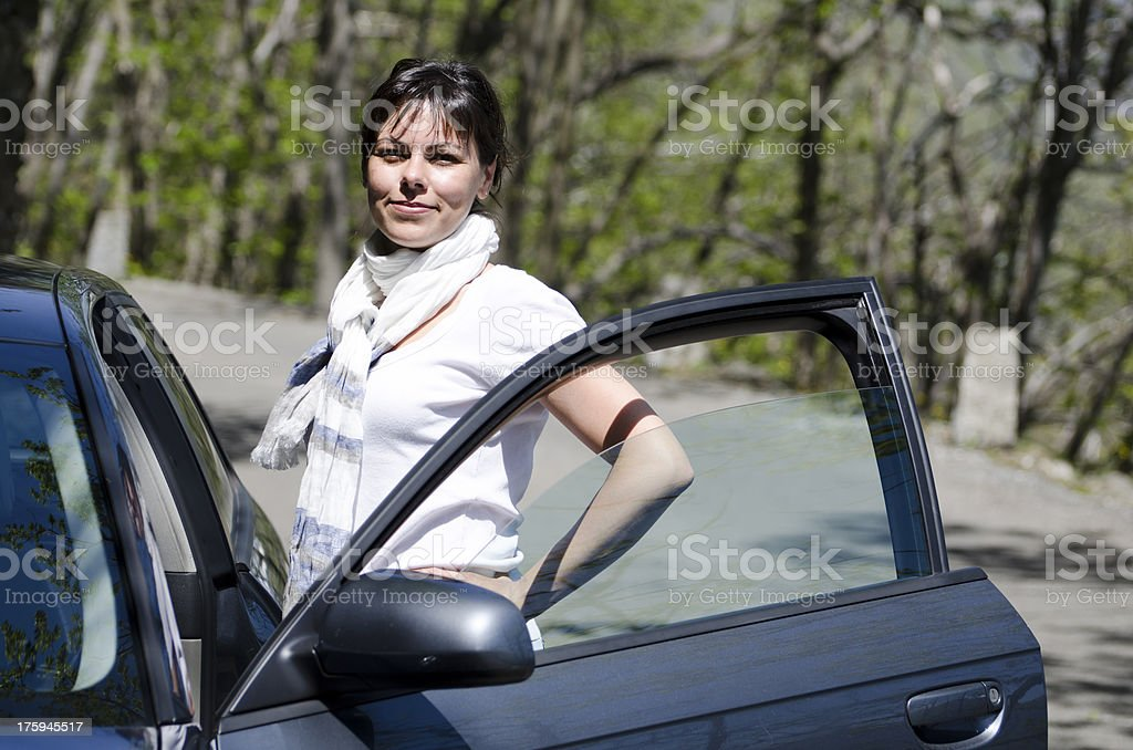 Woman standing next to a car royalty-free stock photo