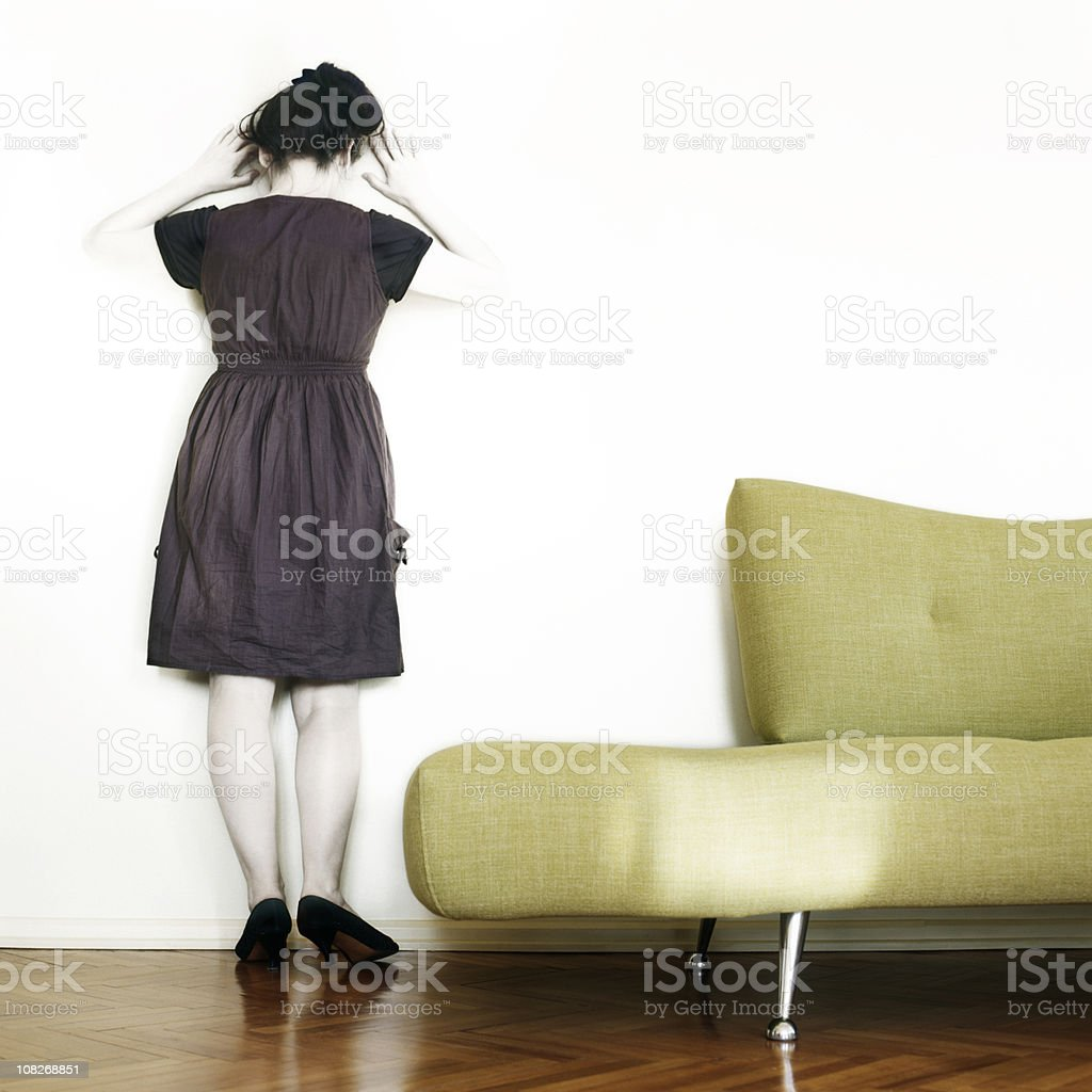 Woman Standing Next to Green Couch royalty-free stock photo