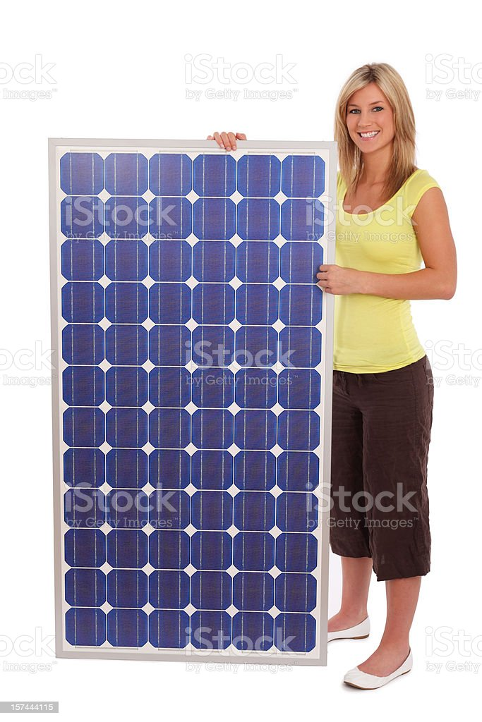 Woman Standing Next To Solar Panel royalty-free stock photo
