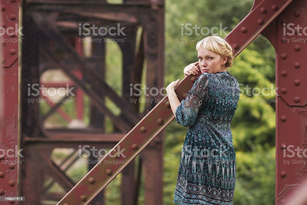 woman standing on bridge bearing royalty-free stock photo