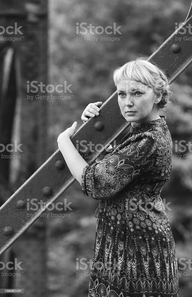woman standing on bridge bearing royalty-free stock photo