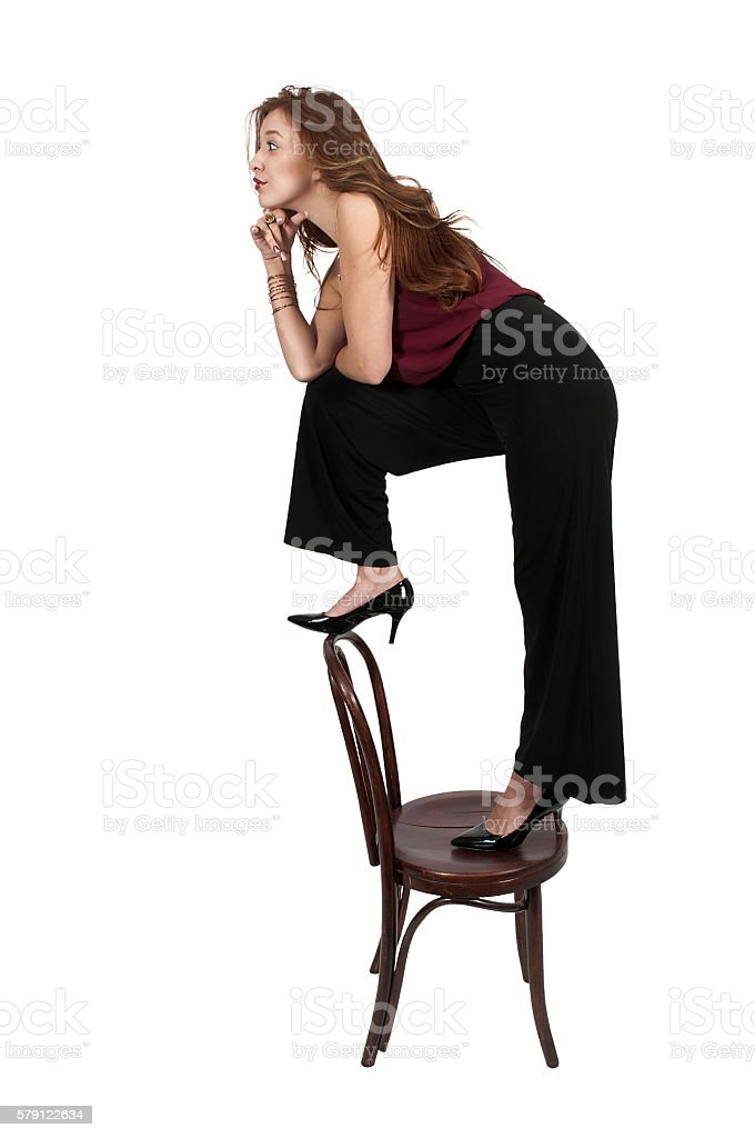 Woman Standing On Chair stock photo