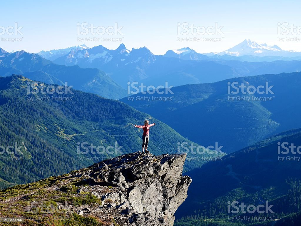 Woman Standing on  Mountain Top. stock photo