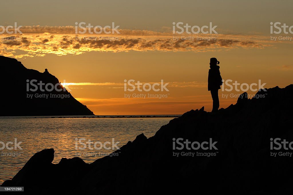Woman Standing on Newfoundland Coastline royalty-free stock photo