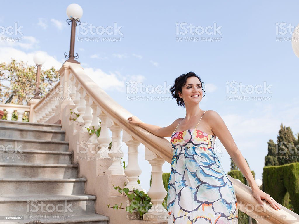 Woman standing on outdoor staircase stock photo