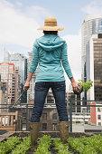Woman standing on roof garden