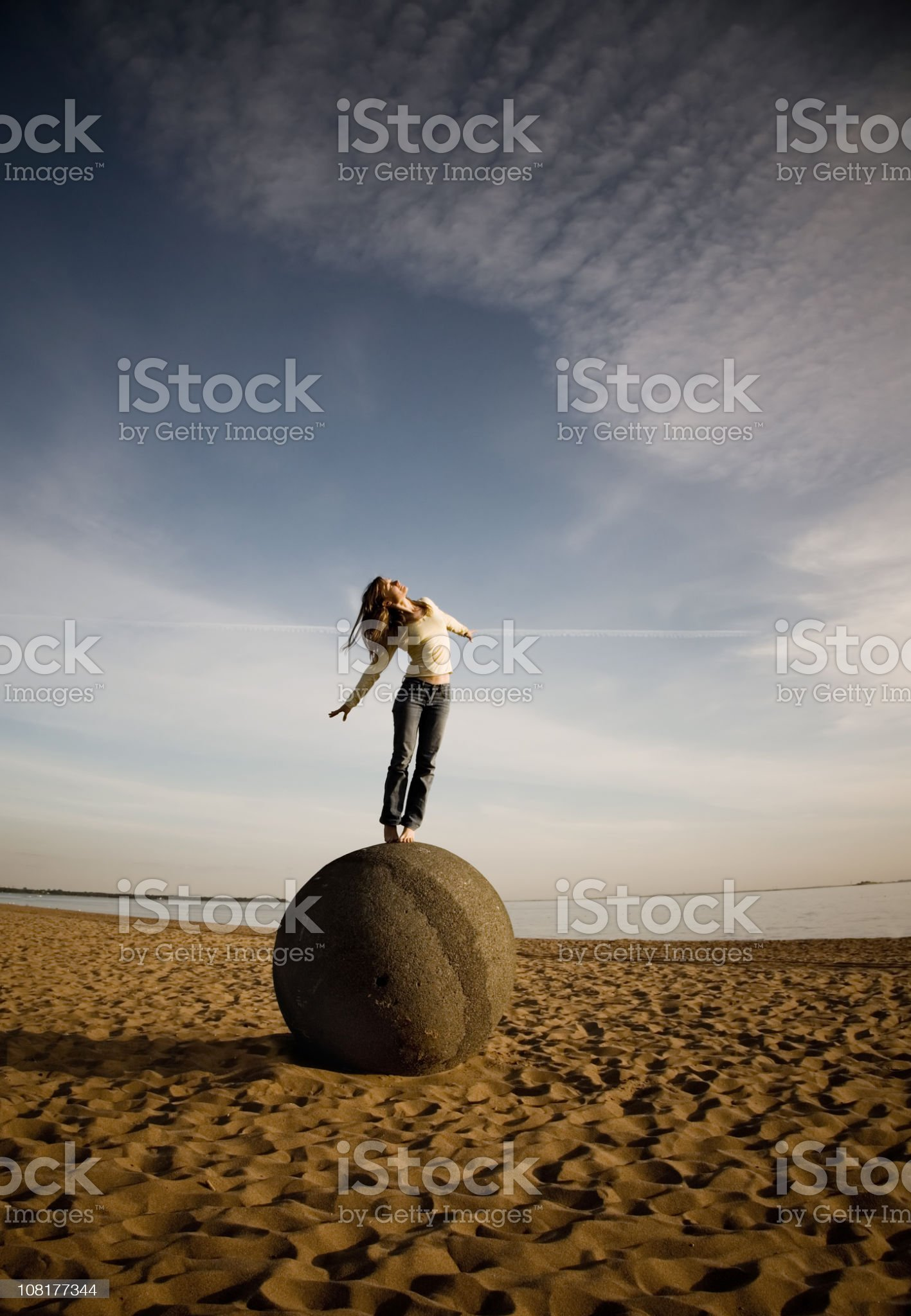Woman Standing on Stone Ball royalty-free stock photo