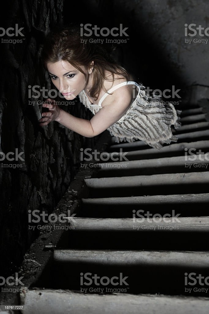 Woman standing on the stairs. royalty-free stock photo