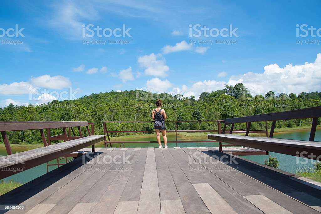 Woman standing on the terrace in good weather stock photo
