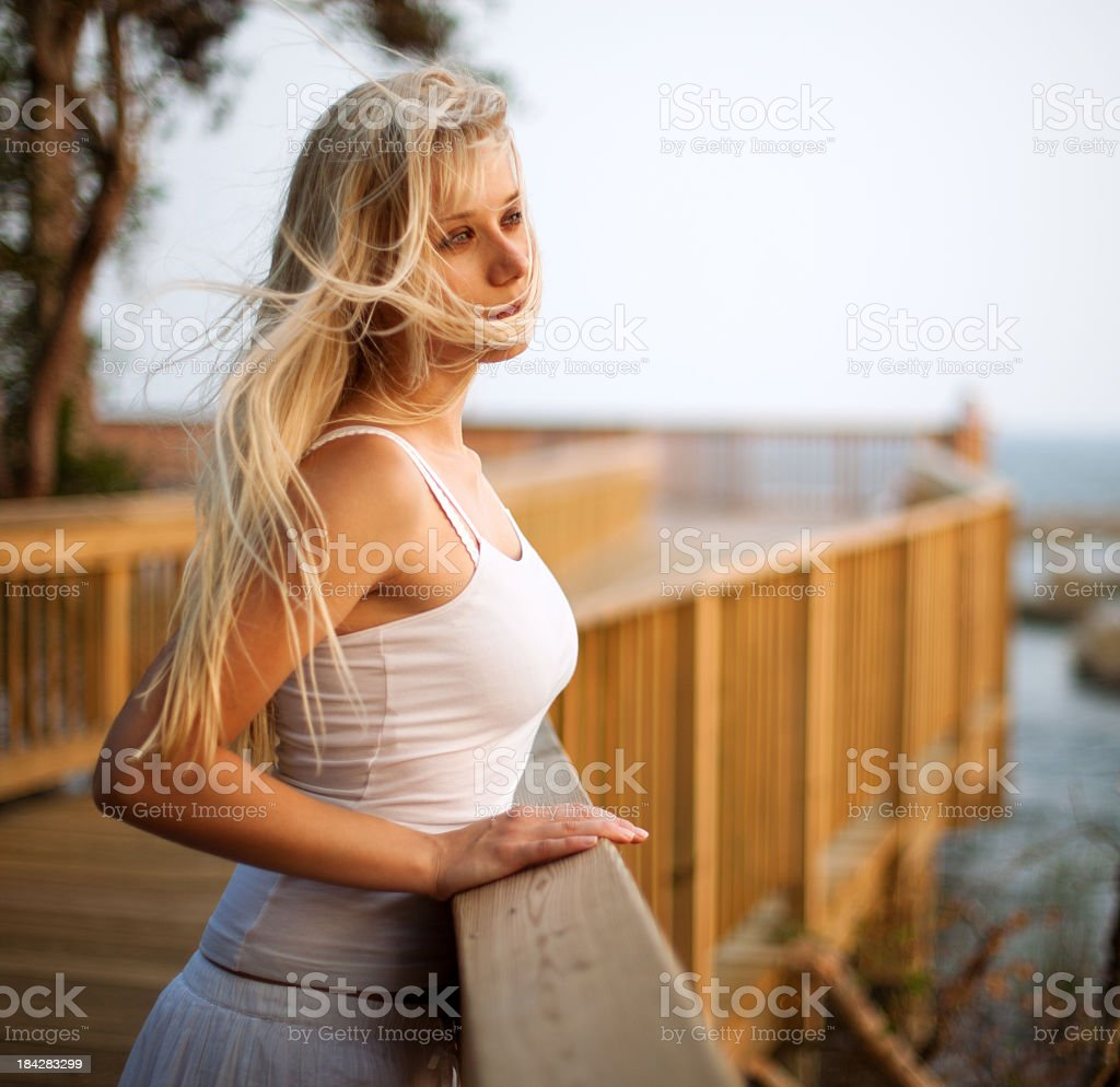 Woman standing on the wooden pier royalty-free stock photo