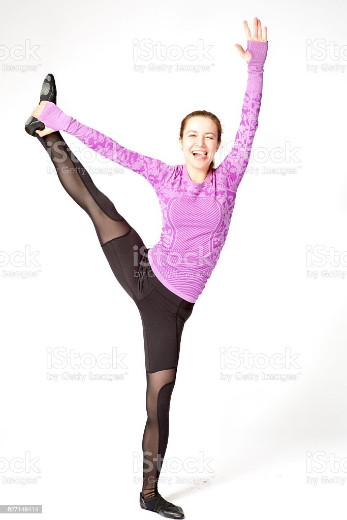 woman standing one leg, with positive emotions and showing tongue stock photo