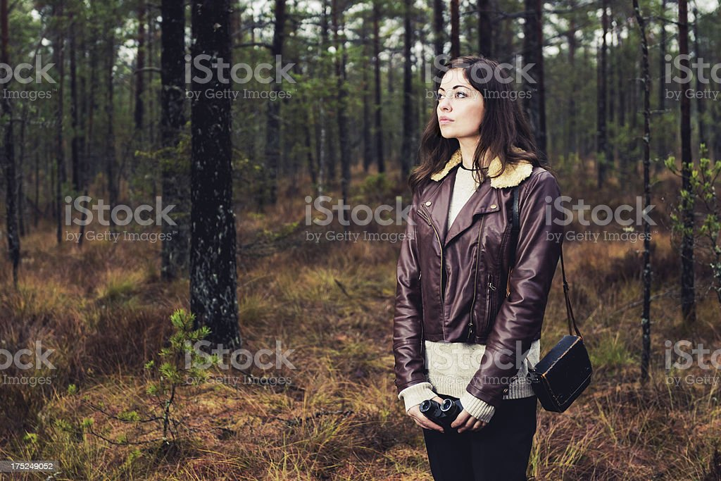 Woman standing outside with binoculars royalty-free stock photo