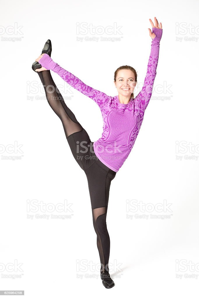 woman standing splits yoga pose with one leg raised up stock photo