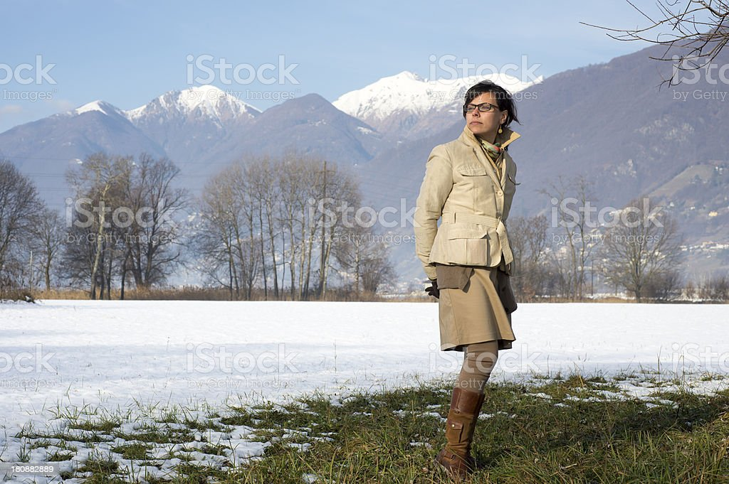 Woman standing up on a field in winter royalty-free stock photo