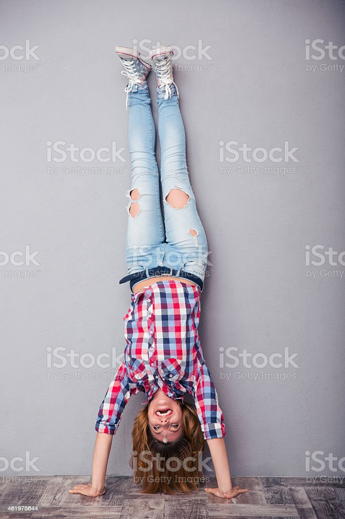 Woman standing upside down stock photo