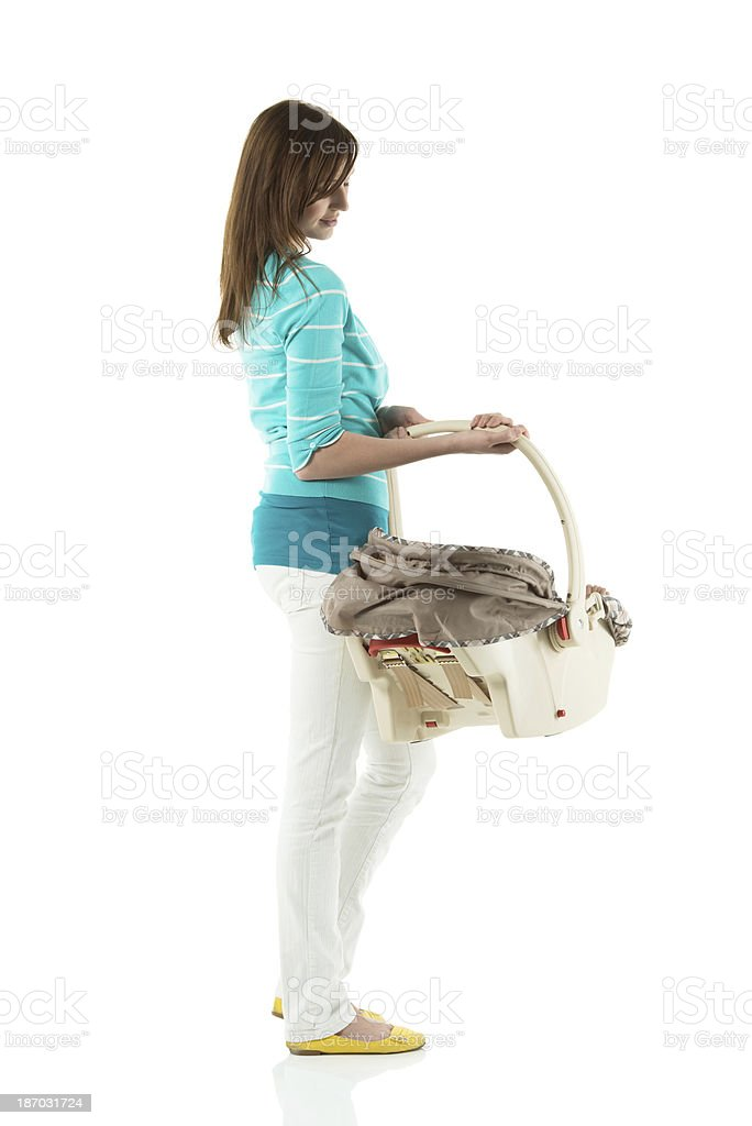 Woman standing with baby in carrier stock photo