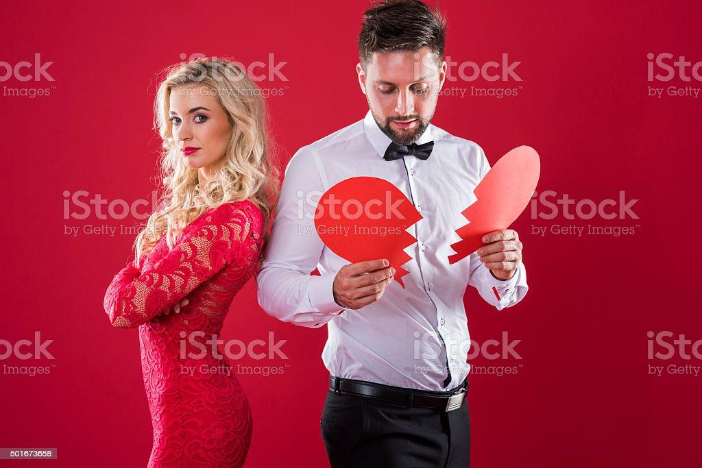 Woman standing with broken heart stock photo