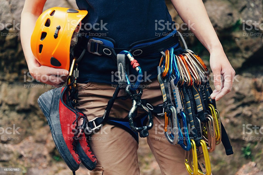Woman standing with climbing equipment stock photo