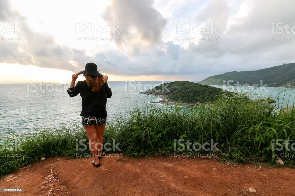 Woman standing with composed at Prom Thep cape stock photo