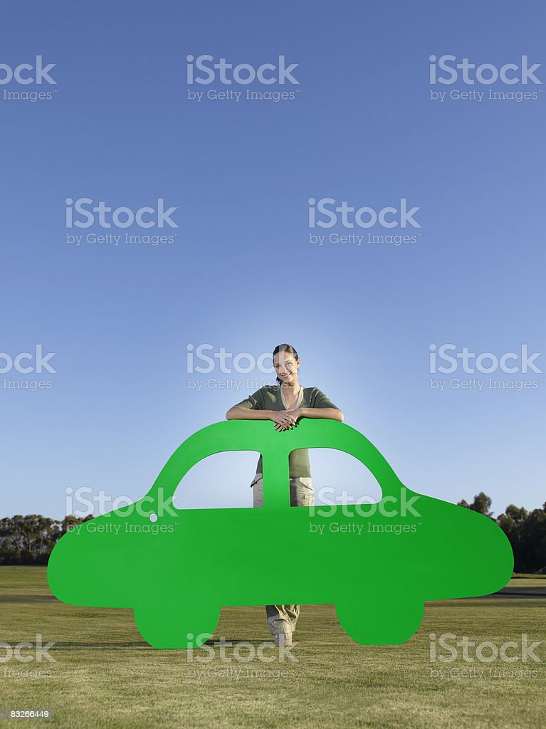 Woman standing with cutout car stock photo
