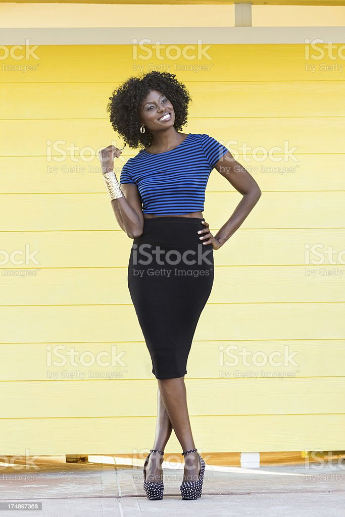 Woman Standing With Hand On Hip Looking Away royalty-free stock photo