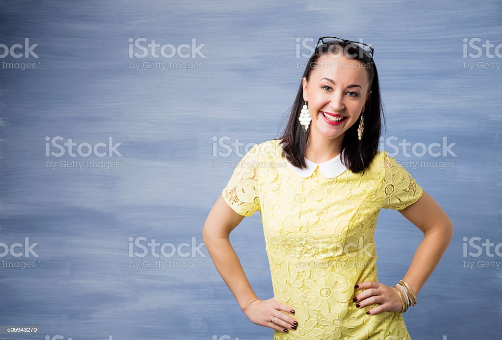 Woman standing with her hands on her hips stock photo