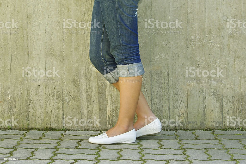 Woman standing with her leg tilted stock photo