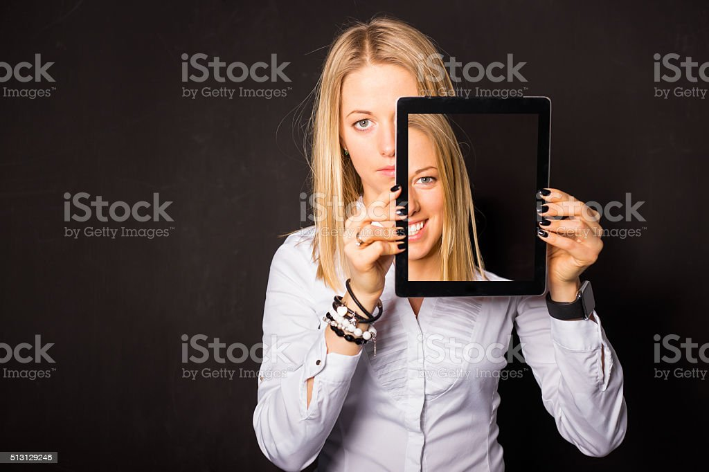 Woman standing with tablet in her hands stock photo