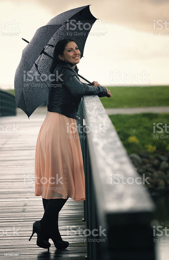 Woman standing with umbrella royalty-free stock photo