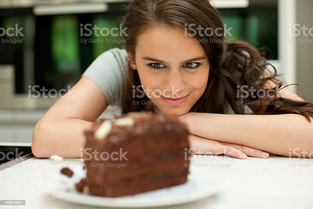 Woman staring at chocolate cake stock photo