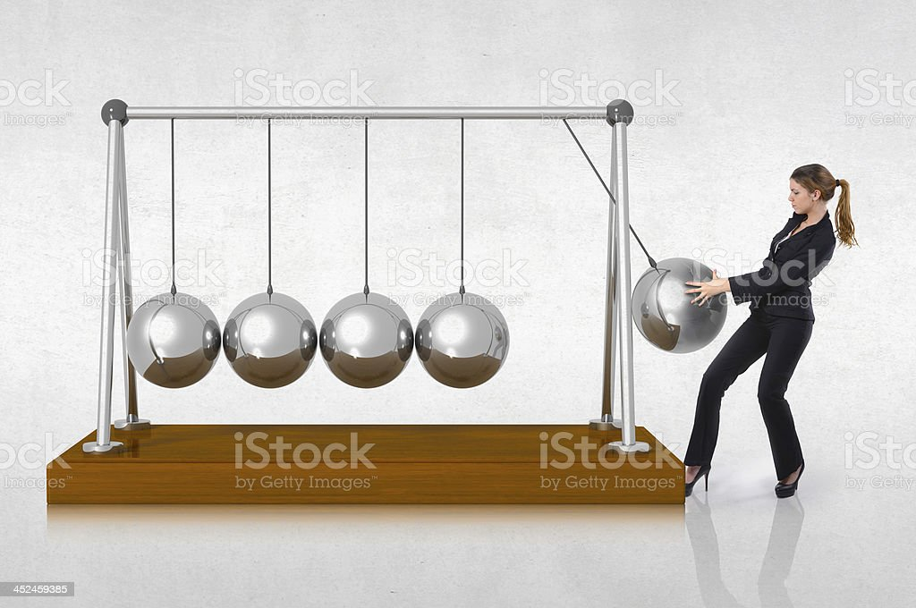 Woman starting a perpetuate motion, business concept stock photo