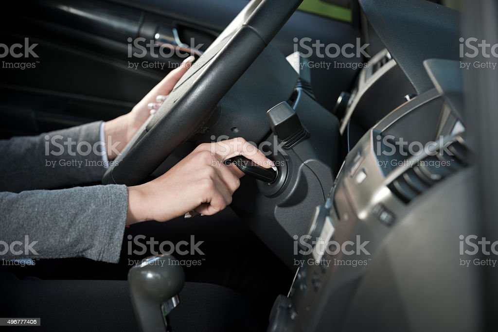 Woman starting car engine stock photo