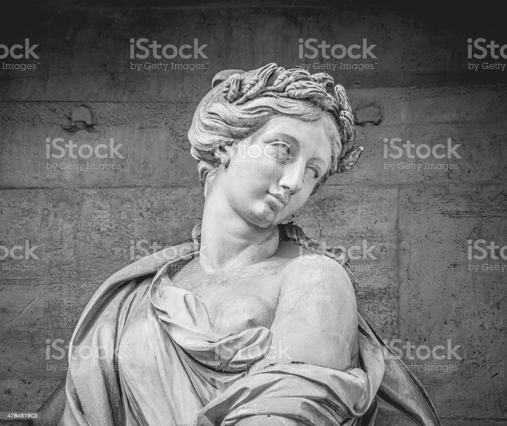 Woman Statue at Trevi Fountain in Rome stock photo