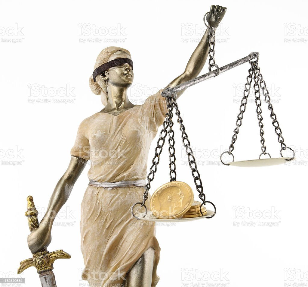 Woman statue of justice with sword royalty-free stock photo