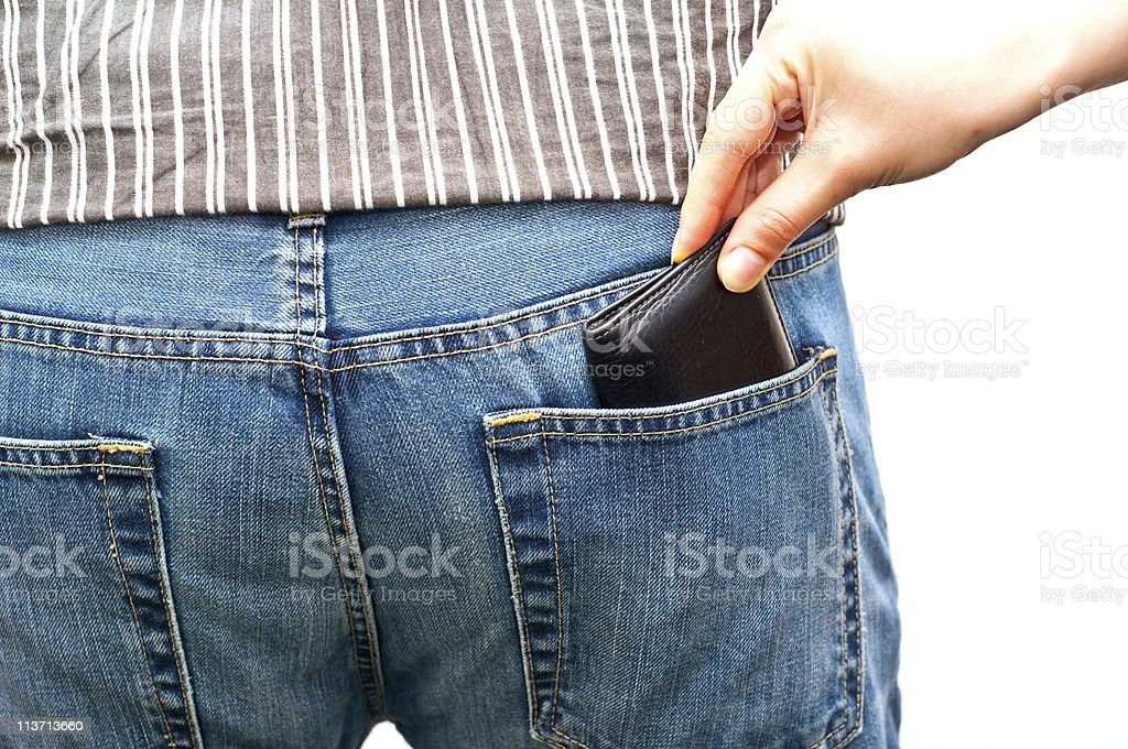 woman stealing a wallet from man's back pocket isolated stock photo