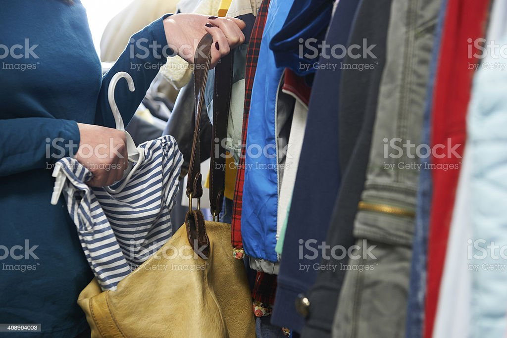 Woman Stealing Clothes From Store stock photo