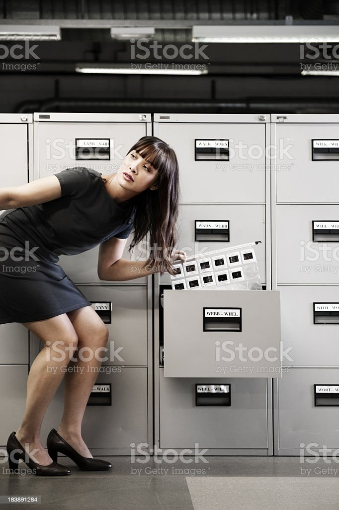 Woman stealing diapositives stock photo