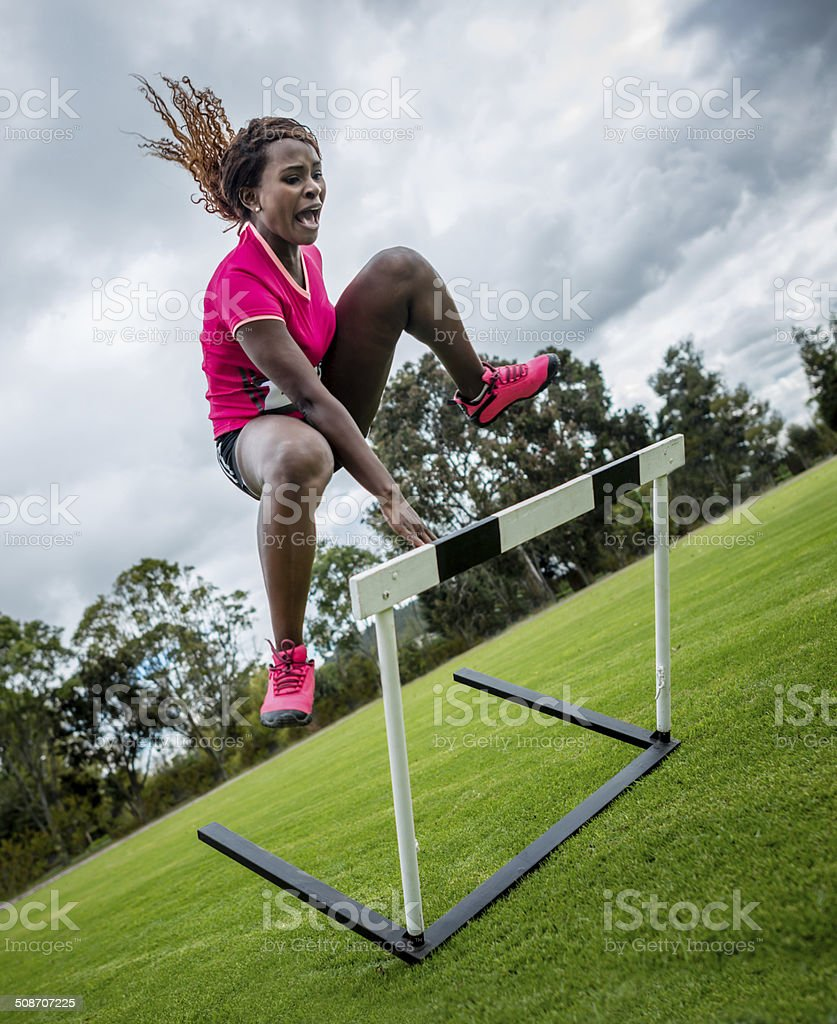 Woman steeple chasing stock photo