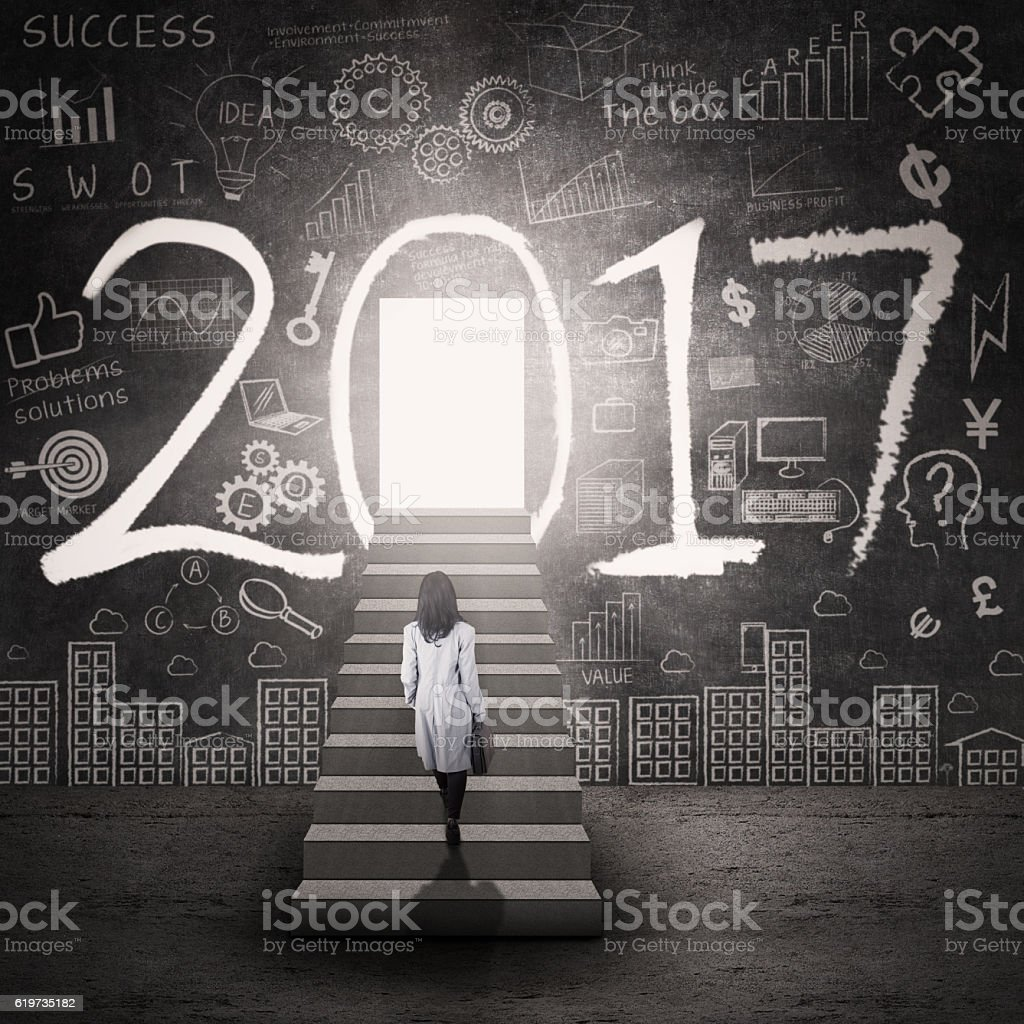 Woman stepping to the door of 2017 royalty-free stock photo & Woman Stepping To The Door Of 2017 stock photo 619735182 | iStock Pezcame.Com