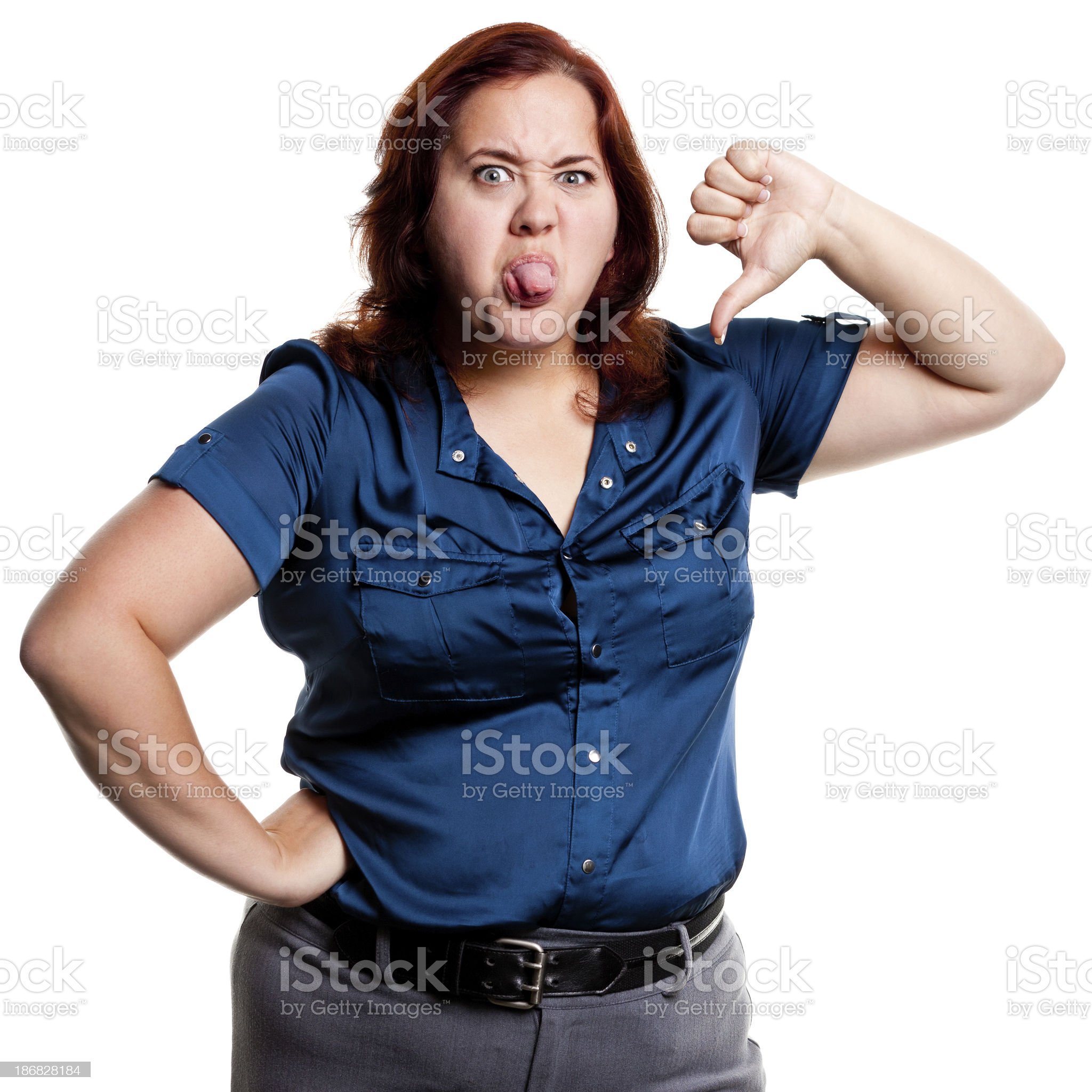 Woman Sticks Out Tongue And Gives Thumbs Down royalty-free stock photo