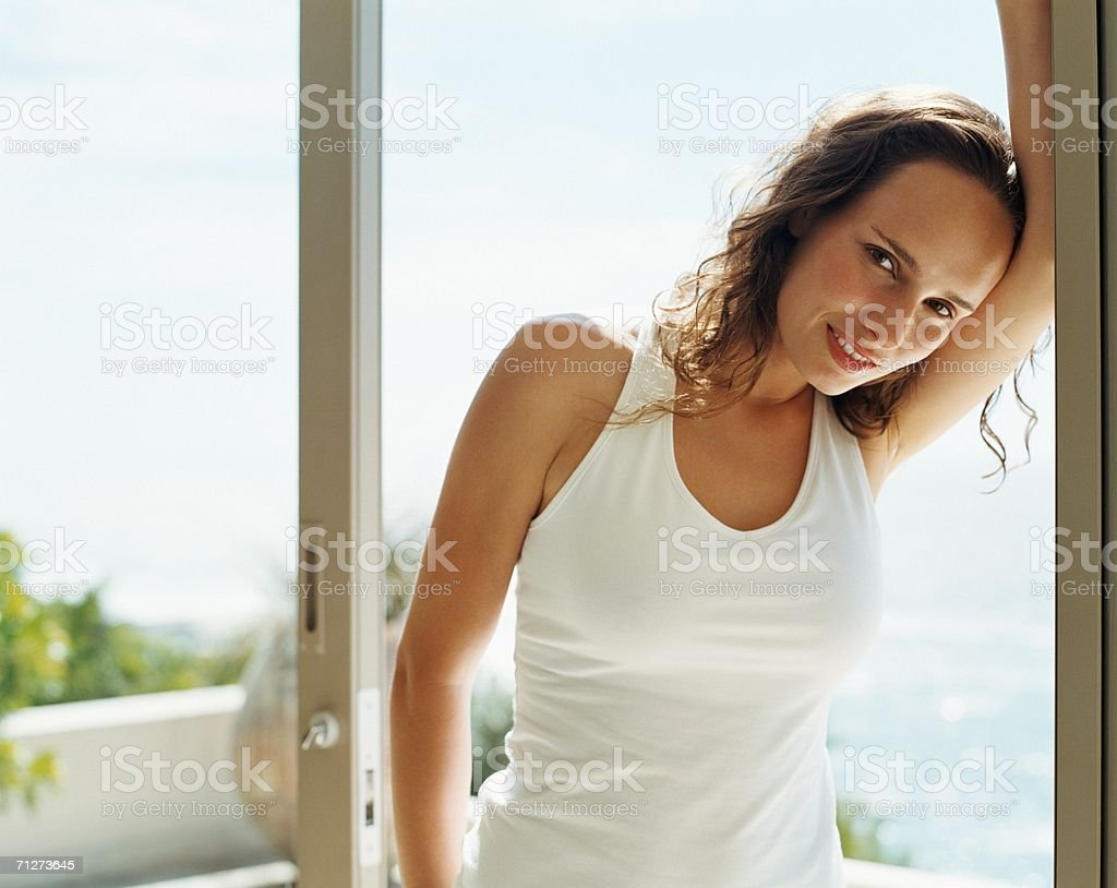 Woman stood leaning against window royalty-free stock photo
