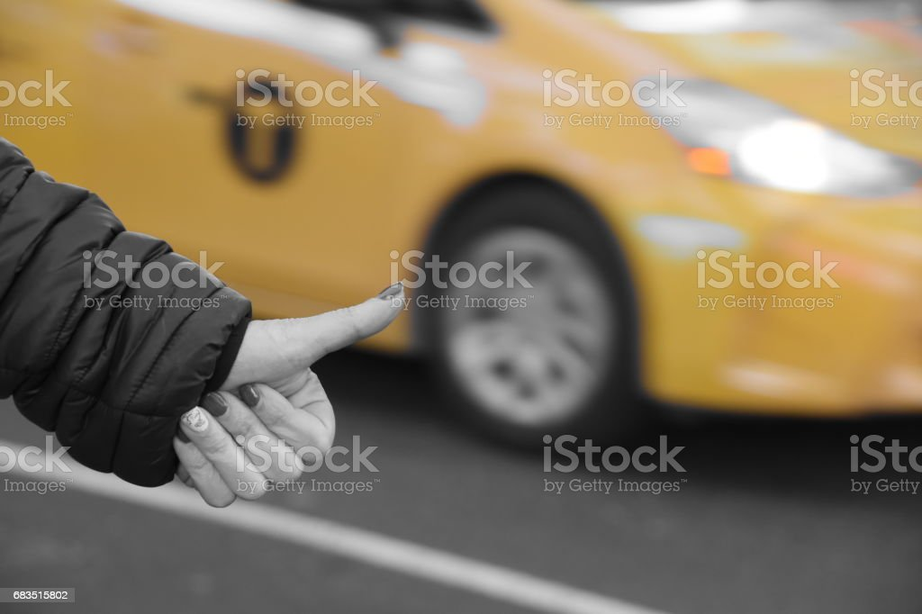 woman stops a yellow taxi in New York stock photo