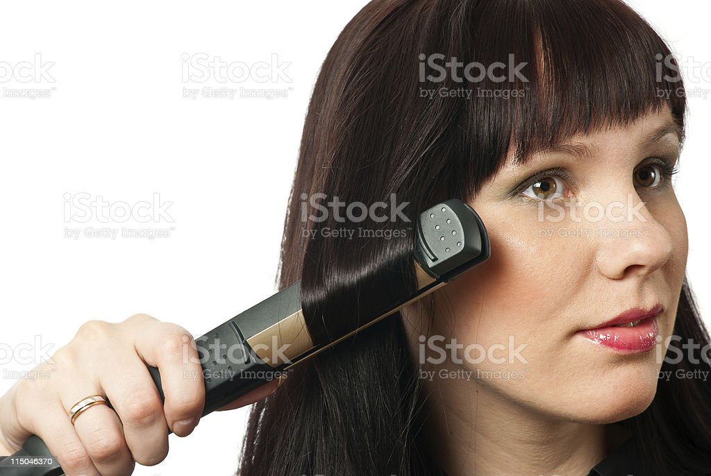 Woman straightening hairs royalty-free stock photo