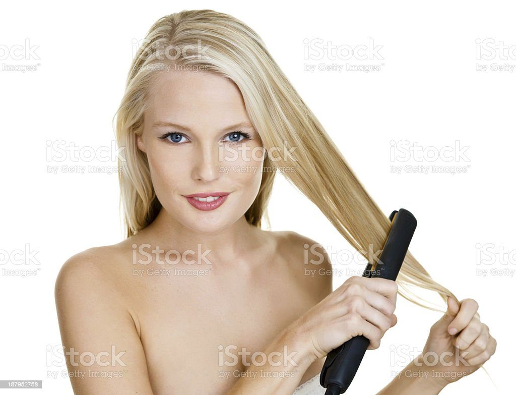 Woman straightening her hair royalty-free stock photo