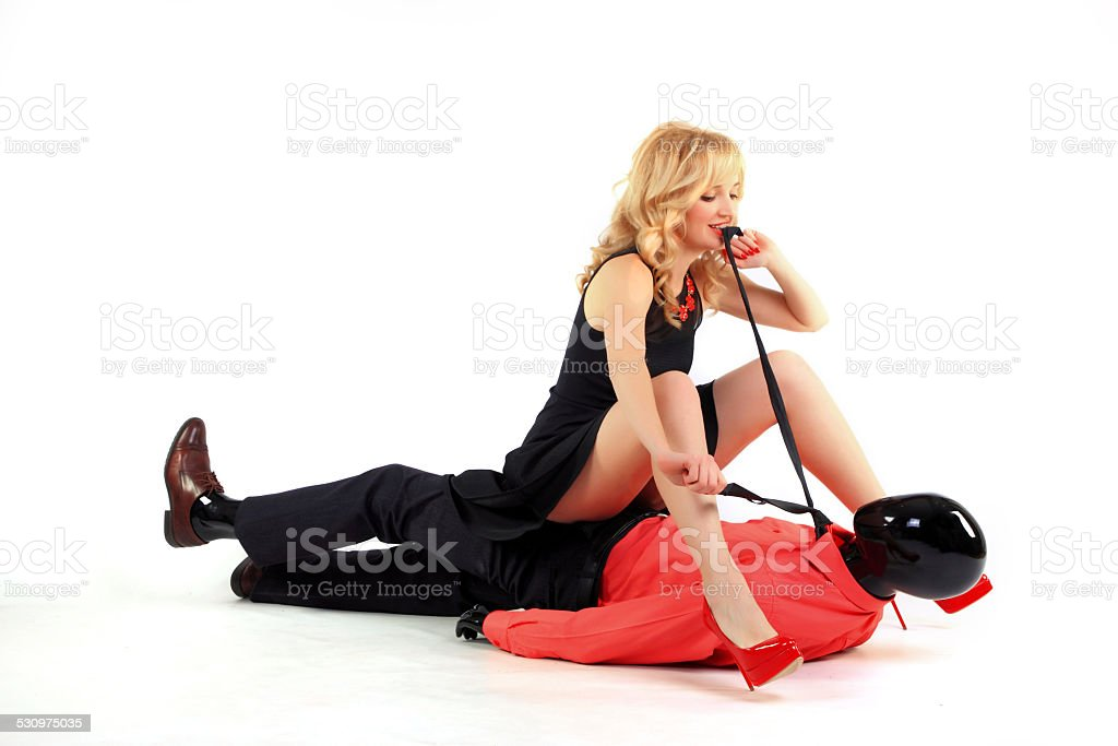 Woman strangles man stock photo