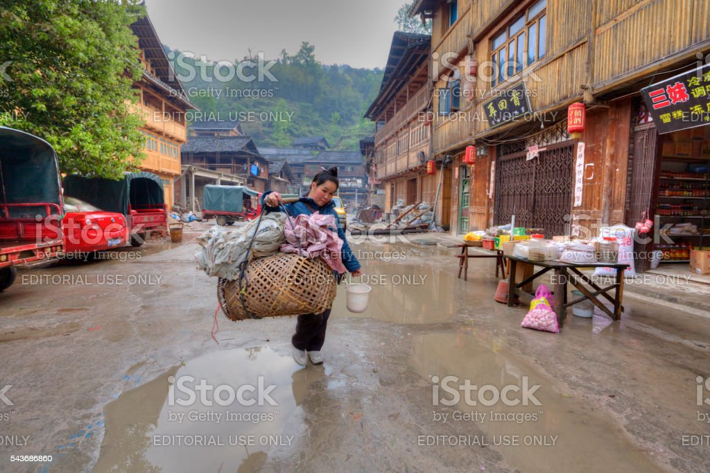 Woman street vendor with a yoke on his shoulder. stock photo