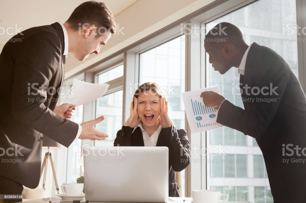 Woman stressed because of mistake in work papers stock photo